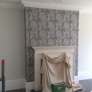 New wallpaper by fireplace