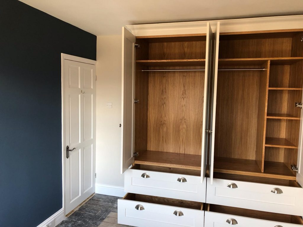 Feature wall and inside of wardrobe after makeover completed