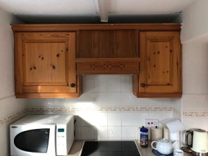 Kitchen cupboards before being redecorated
