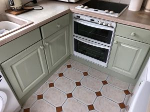 Lower half of kitchen units after being redecorated.